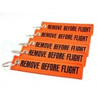 Orange keychain- remove before flight