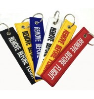 Different colors remove before flight key ring